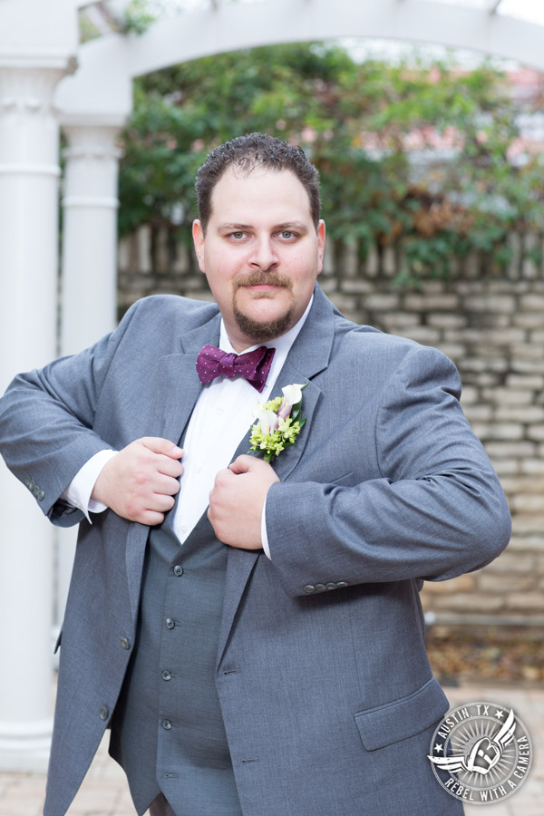 Fun wedding pictures at the Texas Federation of Women's Clubs Mansion - groom in grey suit - Freytag's Florist