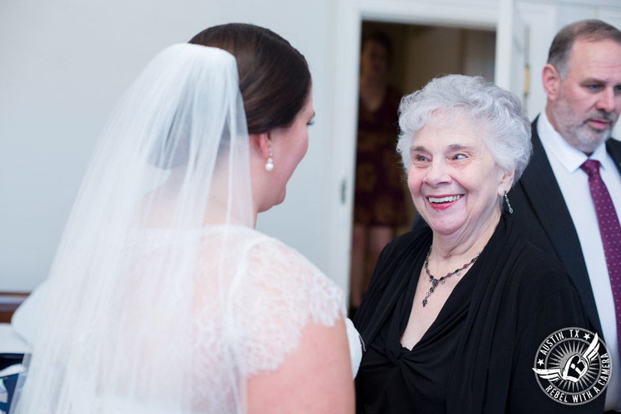 Fun wedding pictures at the Texas Federation of Women's Clubs Mansion - smiling bride sees grandma in the bride's room - Vain Salon - Nicole Schultz Make-Up - Belle Saison Bridal Salon