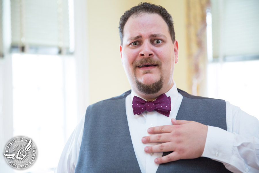 Fun wedding pictures at the Texas Federation of Women's Clubs Mansion - groom in purple bow tie