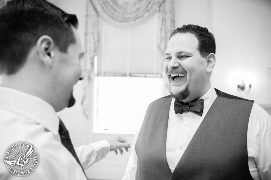 Fun wedding pictures at the Texas Federation of Women's Clubs Mansion - groomsman laughs with groom