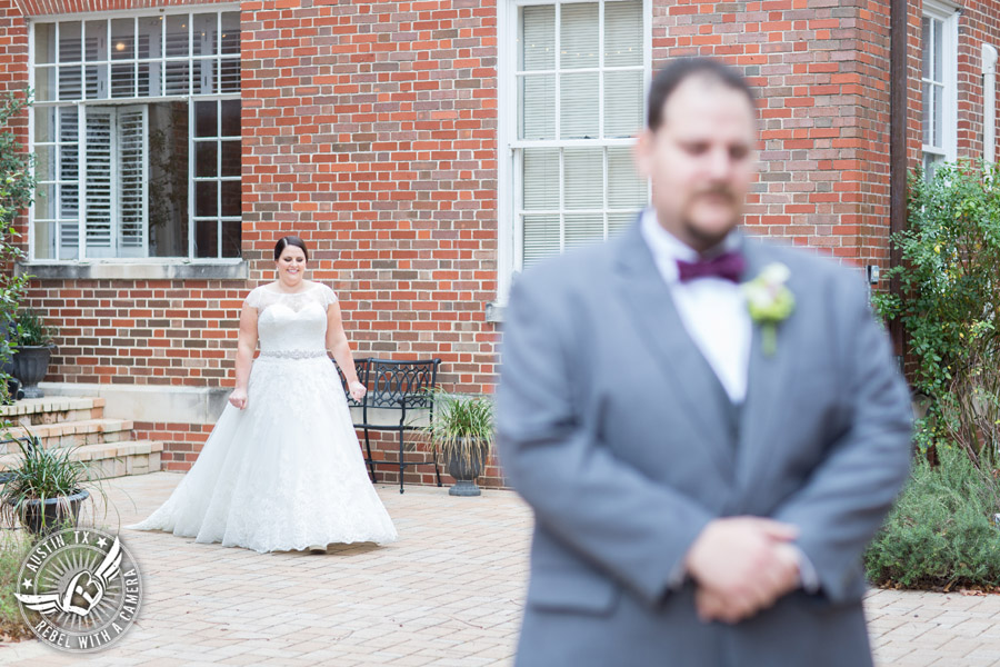 Fun wedding pictures at the Texas Federation of Women's Clubs Mansion - groom in purple bow tie waits for first look with the bride