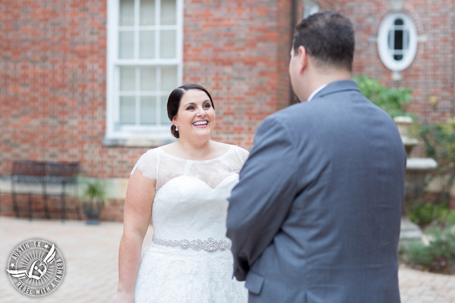 Fun wedding pictures at the Texas Federation of Women's Clubs Mansion - groom sees bride during first look before the wedding ceremony