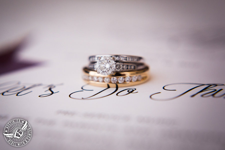 Fun wedding pictures at the Texas Federation of Women's Clubs Mansion - wedding ring shot on wedding invitation