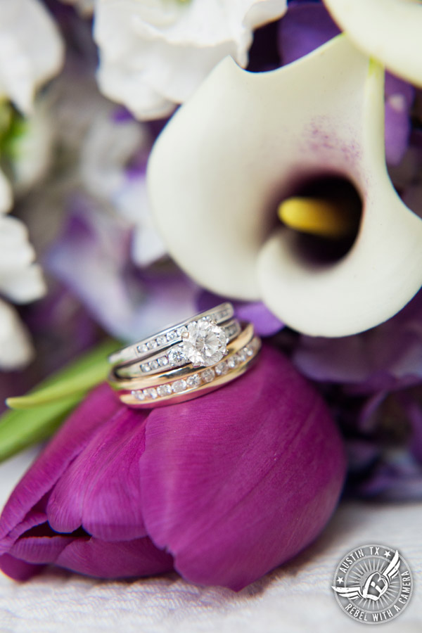 Fun wedding pictures at the Texas Federation of Women's Clubs Mansion - wedding ring shot on bridal bouquet with purple tulips and calla lilies - Freytag's Florist