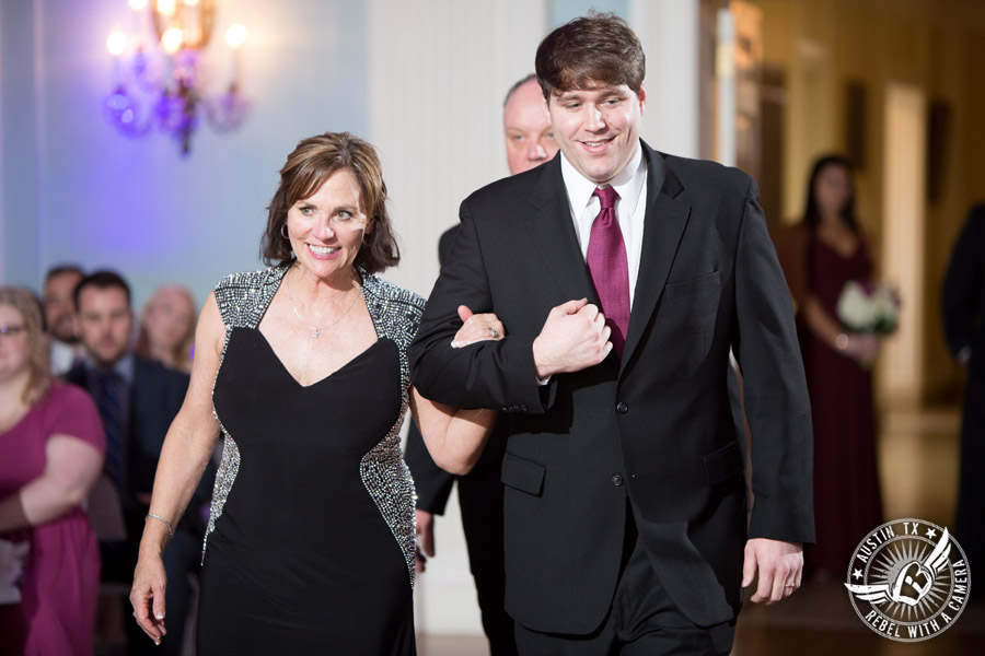 Fun wedding pictures at the Texas Federation of Women's Clubs Mansion - bride's mother is escorted down the aisle during the wedding ceremony