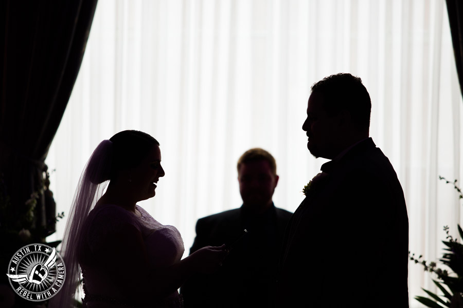Fun wedding pictures at the Texas Federation of Women's Clubs Mansion - silhouette of bride and groom during the wedding ceremony