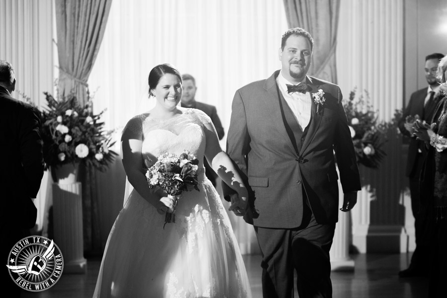 Fun wedding pictures at the Texas Federation of Women's Clubs Mansion - bride and groom walk down the aisle at the end of the wedding ceremony