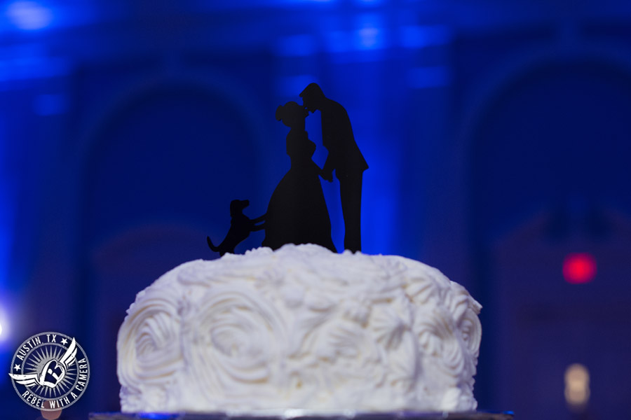 Fun wedding pictures at the Texas Federation of Women's Clubs Mansion - bride and groom kissing silhouette with dog cake topper on buttercream rosette cake