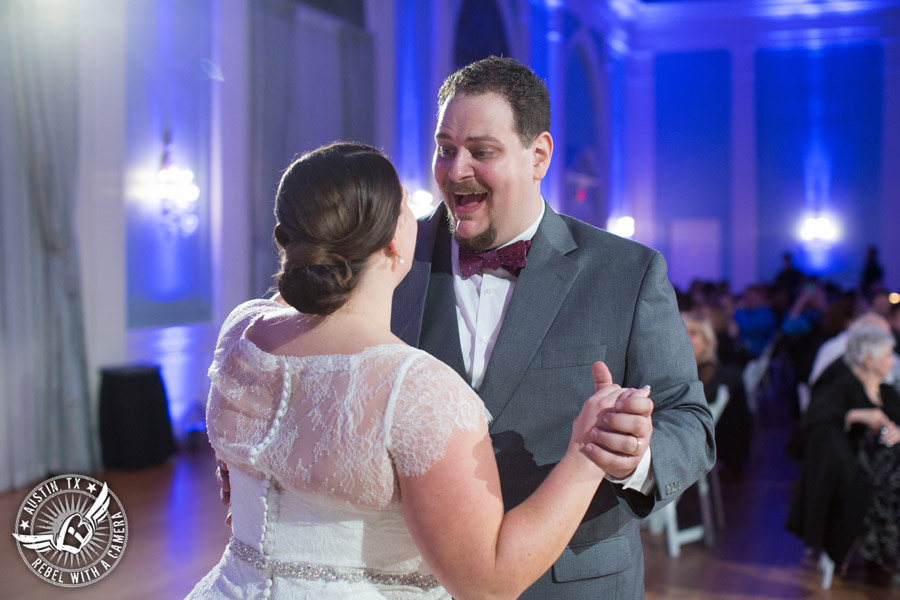Fun wedding pictures at the Texas Federation of Women's Clubs Mansion - bride and groom dance their first dance with The Austin NINES band