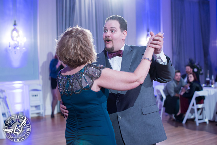 Fun wedding pictures at the Texas Federation of Women's Clubs Mansion - groom dances first dance with his mother - The Austin NINES band