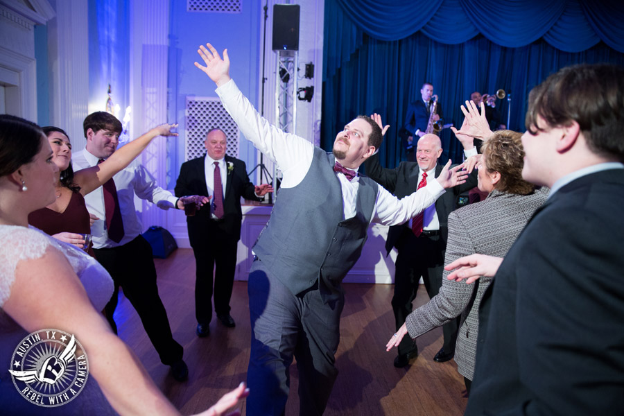 Fun wedding pictures at the Texas Federation of Women's Clubs Mansion - groom dances with guests - The Austin NINES band
