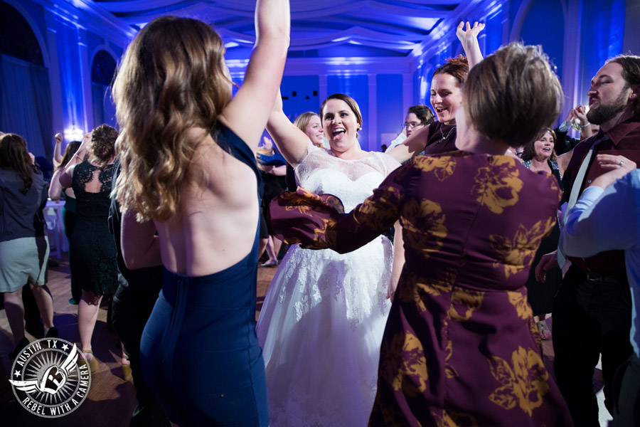 Fun wedding pictures at the Texas Federation of Women's Clubs Mansion - bride dances with guests - The Austin NINES band
