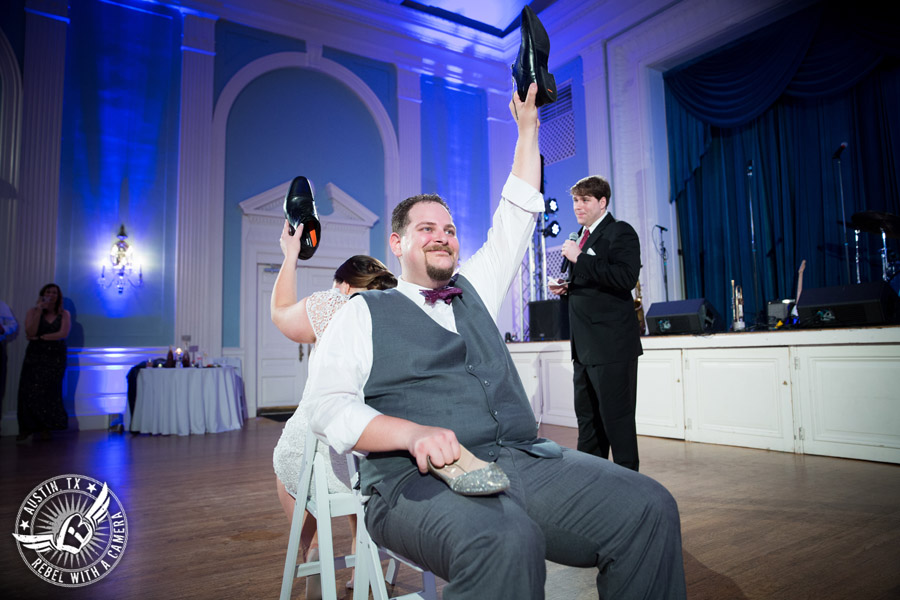 Fun wedding pictures at the Texas Federation of Women's Clubs Mansion - bride and groom play shoe game at wedding reception - David Young Presents - The Austin NINES band