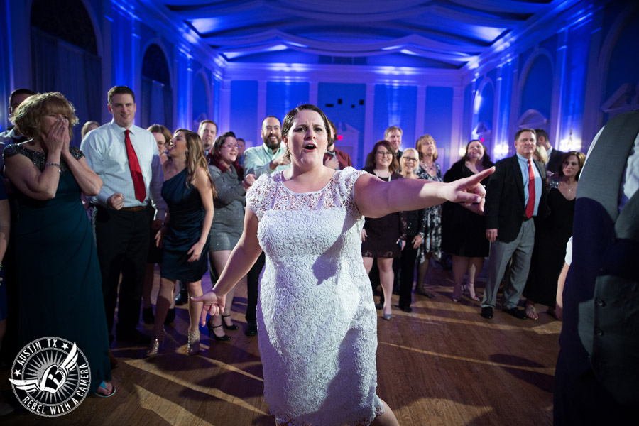 Fun wedding pictures at the Texas Federation of Women's Clubs Mansion - bride dances at wedding reception - David Young Presents - The Austin NINES band