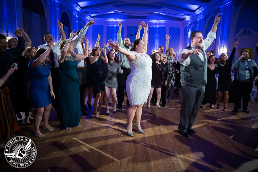 Fun wedding pictures at the Texas Federation of Women's Clubs Mansion - bride and groom dance at wedding reception - David Young Presents - The Austin NINES band