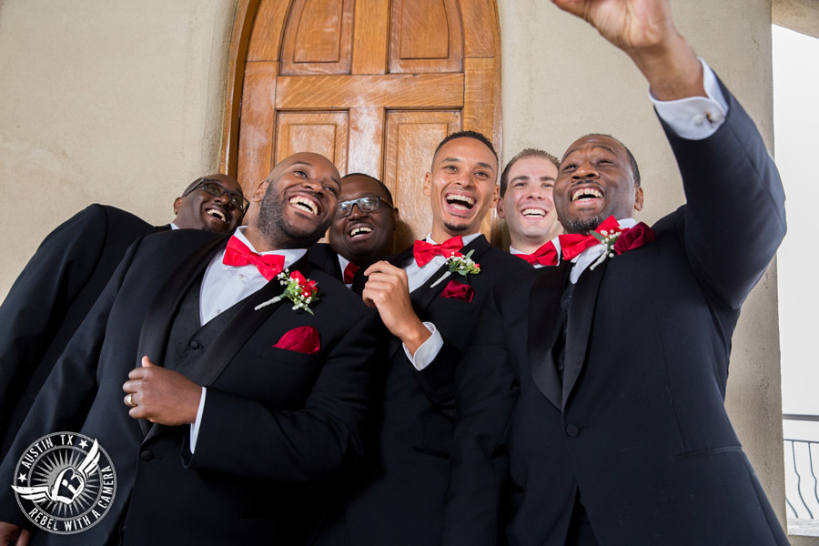 Pictures of weddings at Chapel Dulcinea - groom and groomsmen with red carnation boutonnieres from HEB Blooms