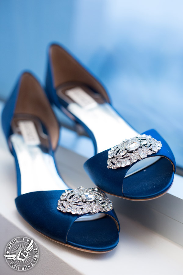 Pictures of bride getting ready at the Radisson in downtown Austin - royal blue Badgley Mischka kitten heels with rhinestone brooch
