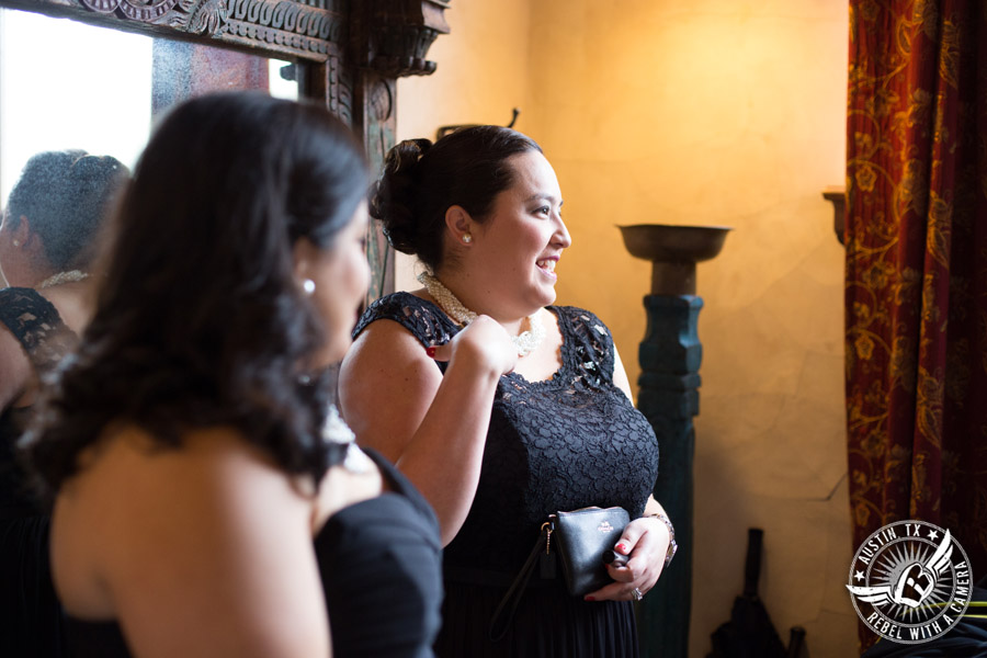 Pictures of bridesmaids getting ready in the bride's room at Chapel Dulcinea in Driftwood, TX