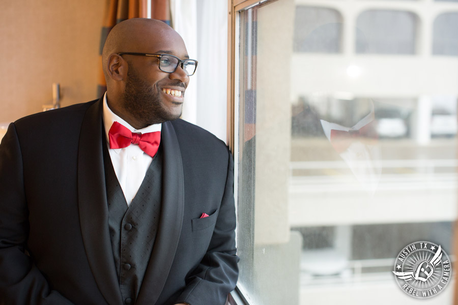 Picture of groom in bow tie getting ready at the Radisson in downtown Austin, TX - Austin Wedding Planners by Rosa
