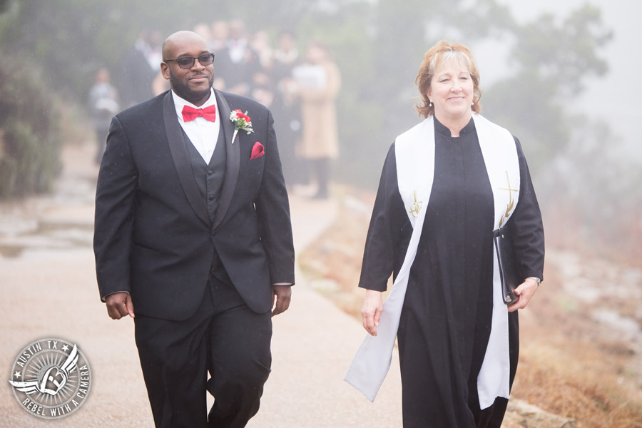 Pictures of weddings at Chapel Dulcinea in Driftwood, TX - groom and officiant walk to ceremony