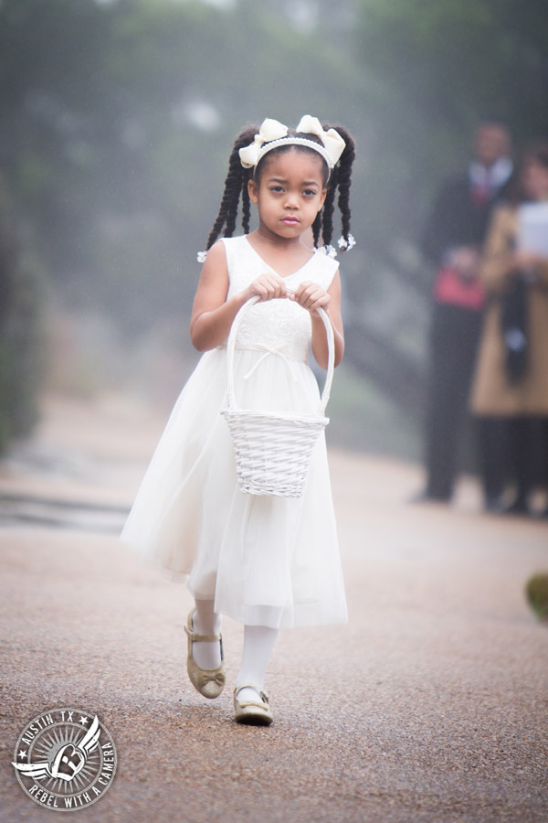 Pictures of weddings at Chapel Dulcinea in Driftwood, TX - flower girl walks to ceremony - Austin Wedding Planners by Rosa