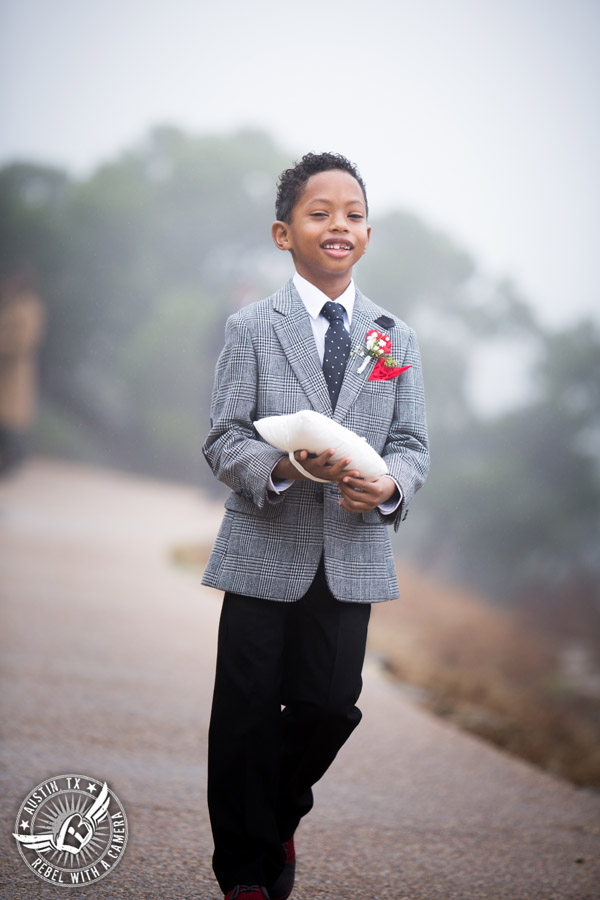 Pictures of weddings at Chapel Dulcinea in Driftwood, TX - ring bearer walks to ceremony