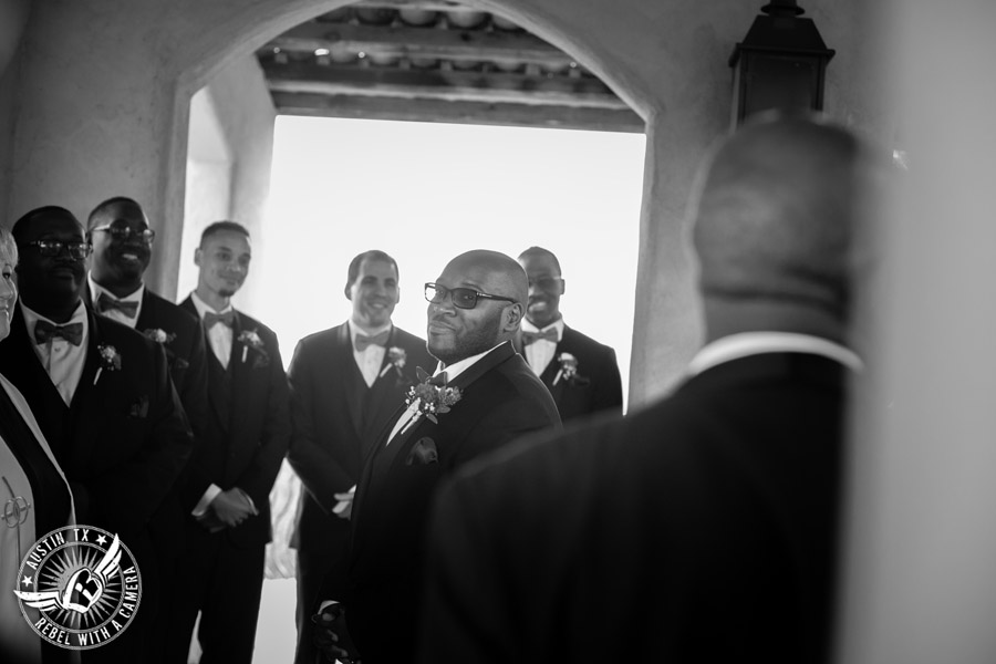 Pictures of weddings at Chapel Dulcinea in Driftwood, TX - groom waits for the bride and her father to walk down the aisle during the ceremony