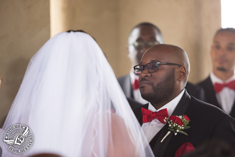 Pictures of weddings at Chapel Dulcinea in Driftwood, TX - groom looks lovingly at the bride during the ceremony