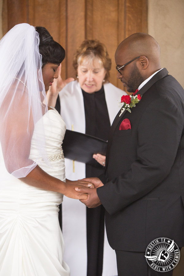 Pictures of weddings at Chapel Dulcinea in Driftwood, TX - bride and groom pray with Rev. Linda McWhorter during the ceremony - Austin Wedding Planners by Rosa
