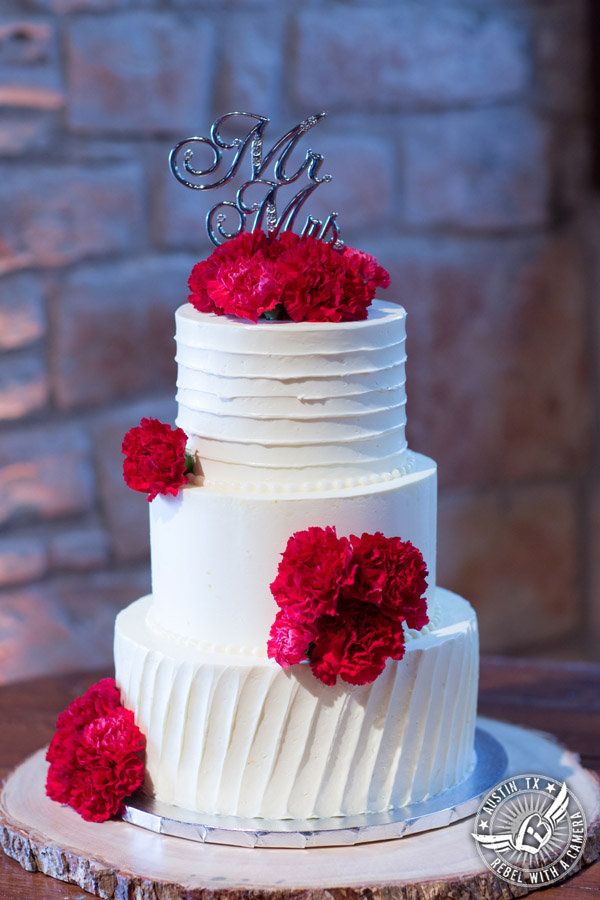 Pictures of weddings at Thurman's Mansion in Driftwood, TX - three tier buttercream wedding cake by Sweetish Hill Bakery with red carnations by HEB Blooms - Austin Wedding Planners by Rosa