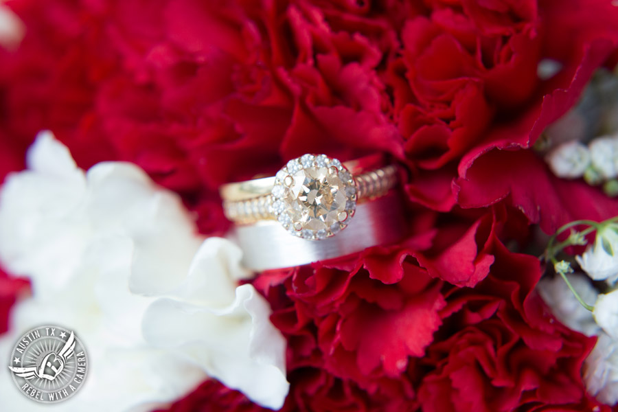 Pictures of weddings at Thurman's Mansion in Driftwood, TX - wedding ring shot with red and white carnations by HEB Blooms - Austin Wedding Planners by Rosa