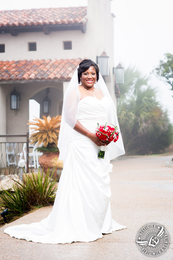 Pictures of weddings at Chapel Dulcinea - bride with red carnation bouquet from HEB Blooms
