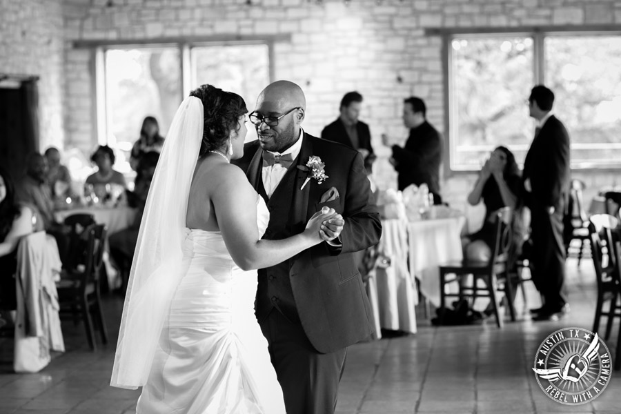 Pictures of weddings at Thurman's Mansion in Driftwood, TX - bride and groom dance first dance during the wedding reception