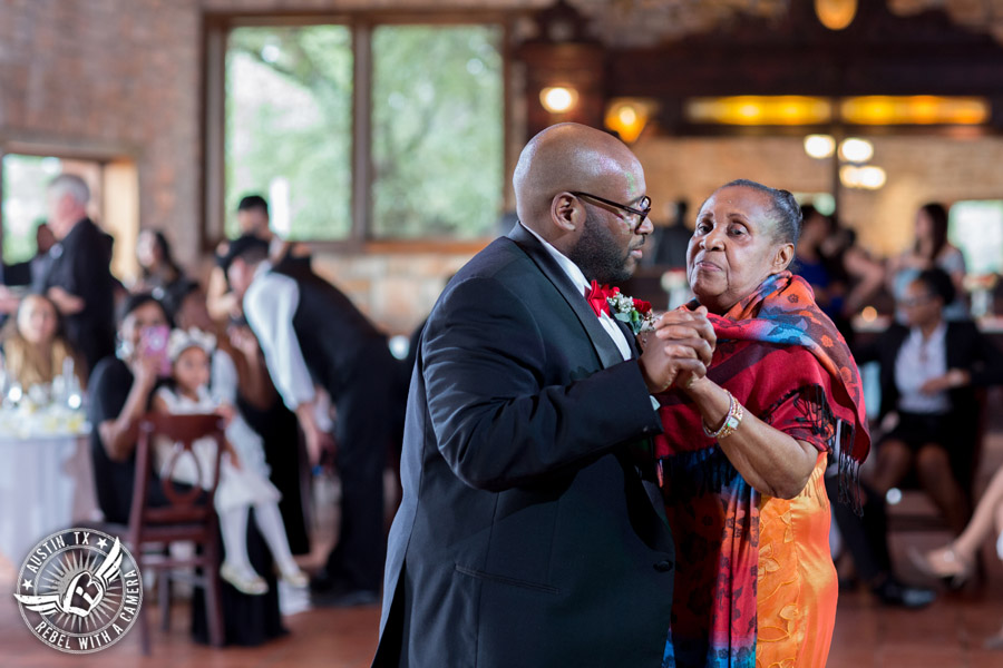 Pictures of weddings at Thurman's Mansion in Driftwood, TX - groom dances mother son dance during the wedding reception - Austin Wedding Planners by Rosa
