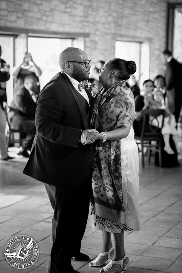 Pictures of weddings at Thurman's Mansion in Driftwood, TX - groom dances mother son dance during the wedding reception