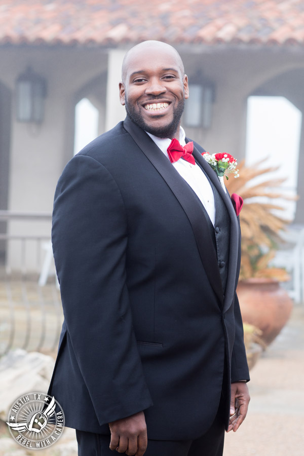Pictures of weddings at Chapel Dulcinea - groom with red carnation boutonniere from HEB Blooms