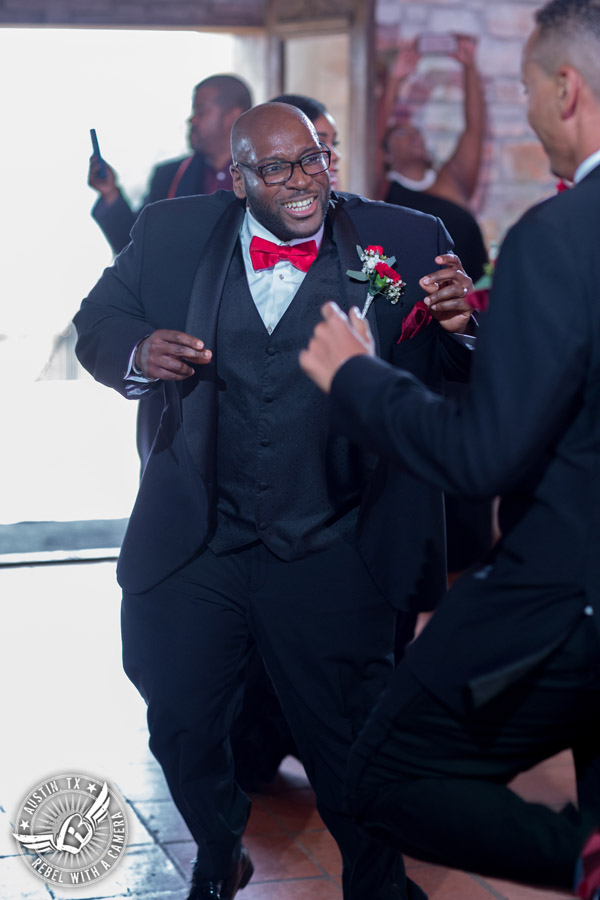 Pictures of weddings at Thurman's Mansion in Driftwood, TX -groom dances during the wedding reception