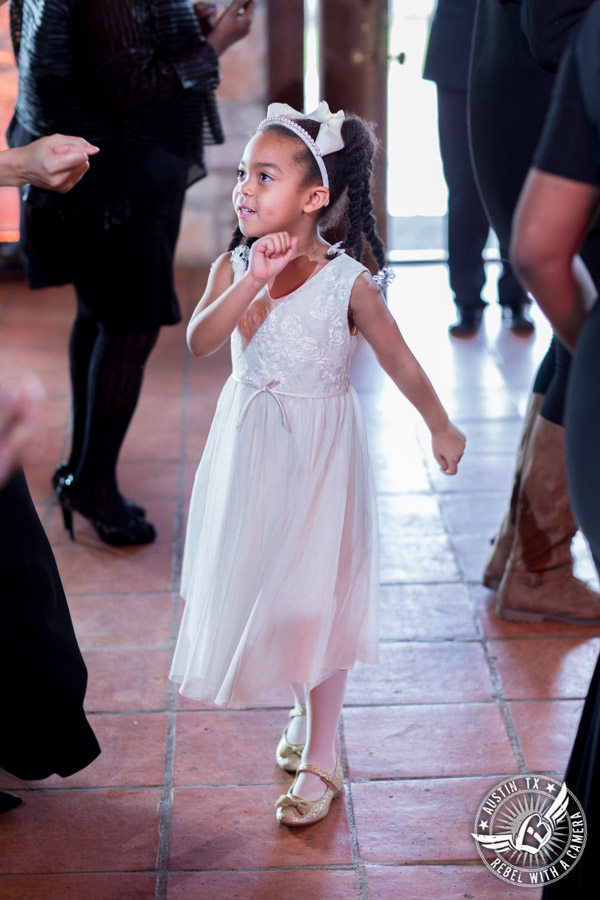 Pictures of weddings at Thurman's Mansion in Driftwood, TX - flower girl dances during the wedding reception