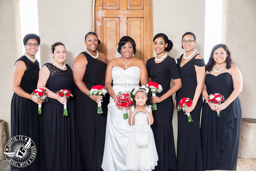 Pictures of weddings at Chapel Dulcinea - bride and bridesmaids with red carnation bouquets from HEB Blooms - Austin Wedding Planners by Rosa