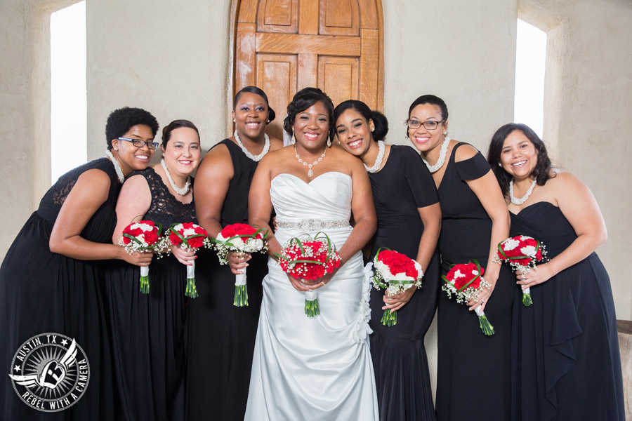 Pictures of weddings at Chapel Dulcinea - bride and bridesmaids with red carnation bouquets from HEB Blooms