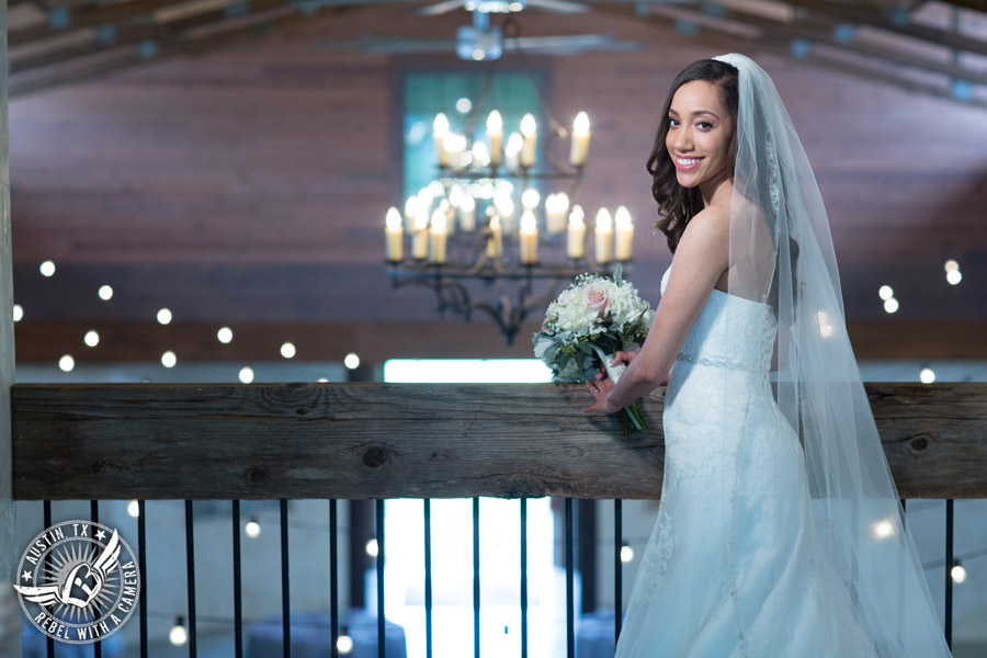 Lone Oak Barn wedding photos - bride on the balcony with bouquet from ParkCrest Floral Design