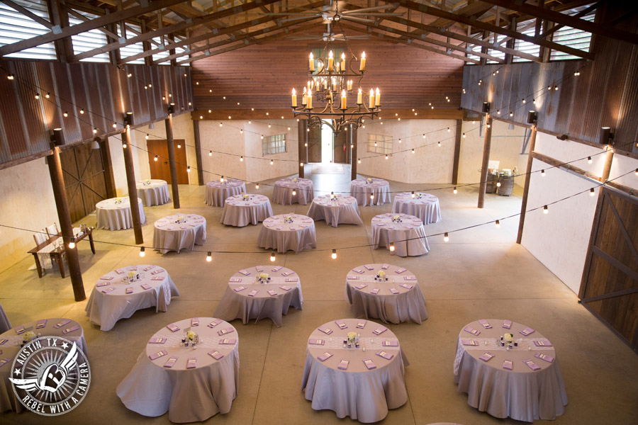 Lone Oak Barn wedding photos - lavender table linens from Monarch Event Rentals in the Main Hall