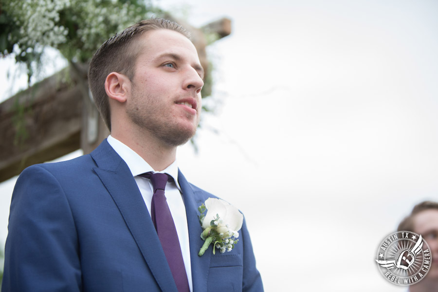 Lone Oak Barn wedding photos - groom sees bride as she walks down the aisle during the wedding ceremony