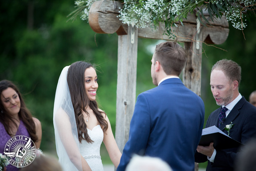 Lone Oak Barn wedding photos - bride looks lovingly at the groom during the wedding ceremony