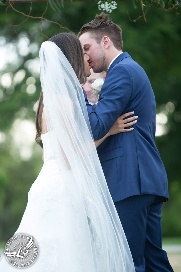Lone Oak Barn wedding photos - bride and groom kiss at the end of the wedding ceremony