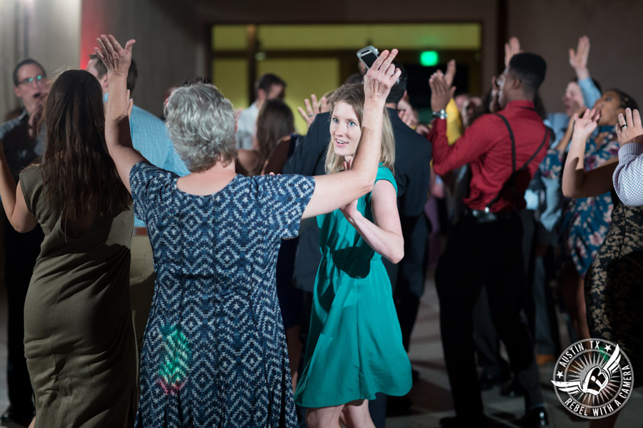 Lone Oak Barn wedding photos - guests dance at the wedding reception in the South Hall with a Complete Austin DJ