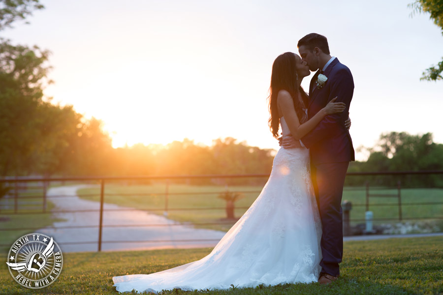 Lone Oak Barn wedding photos - bride and groom kiss in the sunset