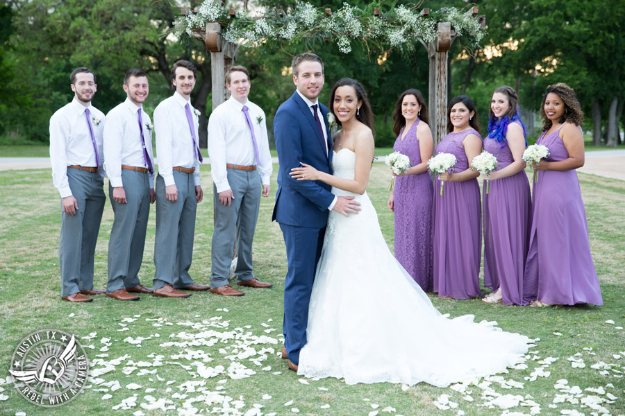 Lone Oak Barn wedding photos - bride and groom with wedding party at the ceremony arbor
